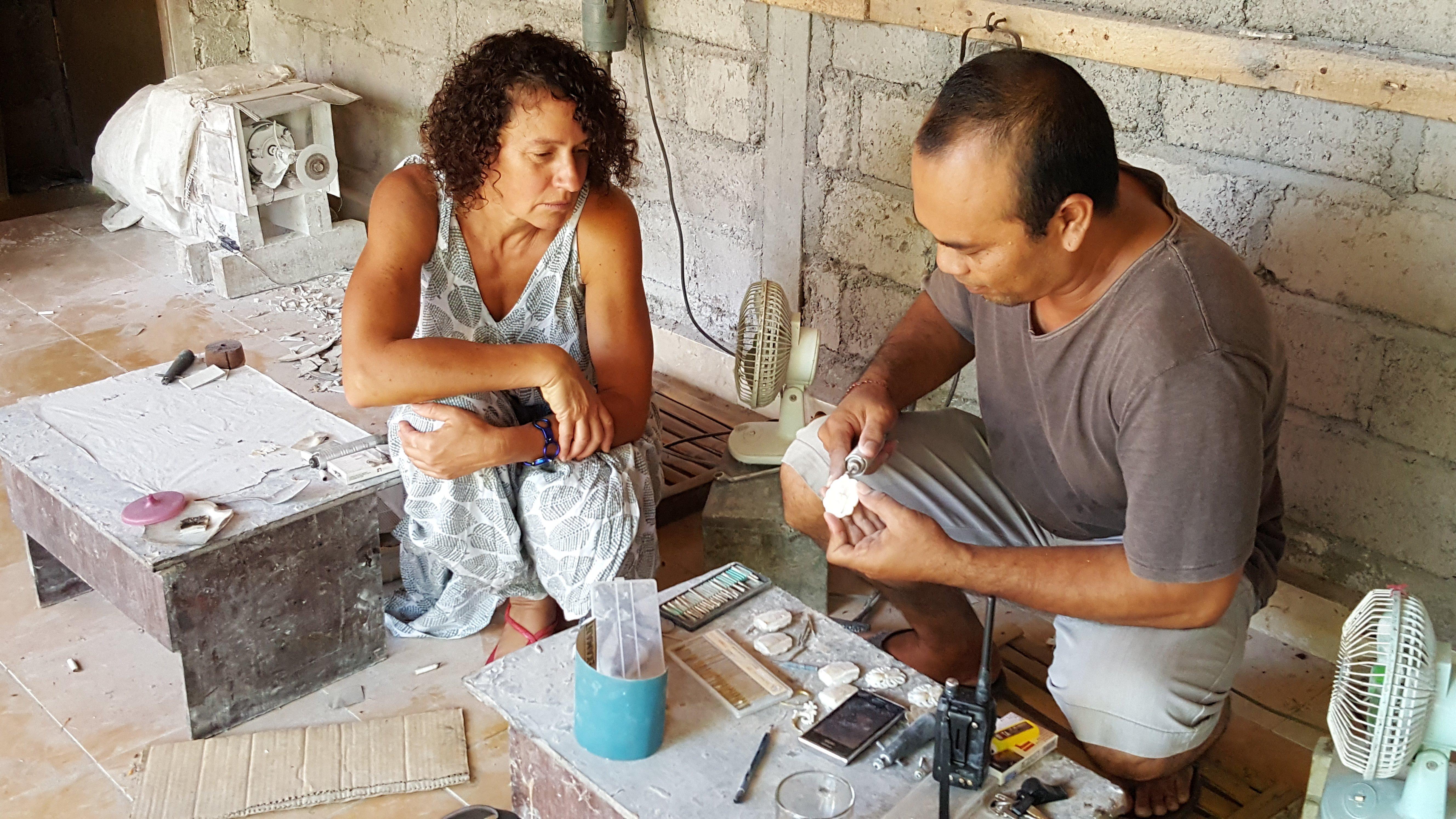 Local artisan practicing traditional bone carving.